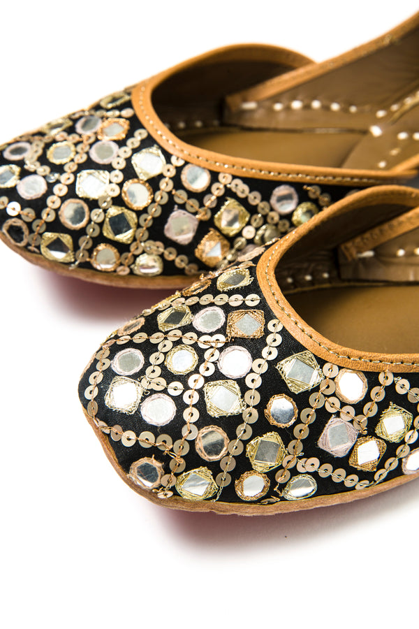 Handcrafted black flats, inspired by the traditional form of South Asian Khussa/Jutti. Made with 100% genuine leather. Mirror work flats to keep you comfortable regardless of the occasion.