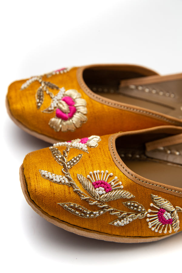 Handcrafted yellow flats, inspired by South Asian Khussa/Jutti design. Made with 100% genuine leather. Comfortable fancy flats perfect for any occasion, especially for a daytime wedding. Pink embroidery, made for a mehndi function.
