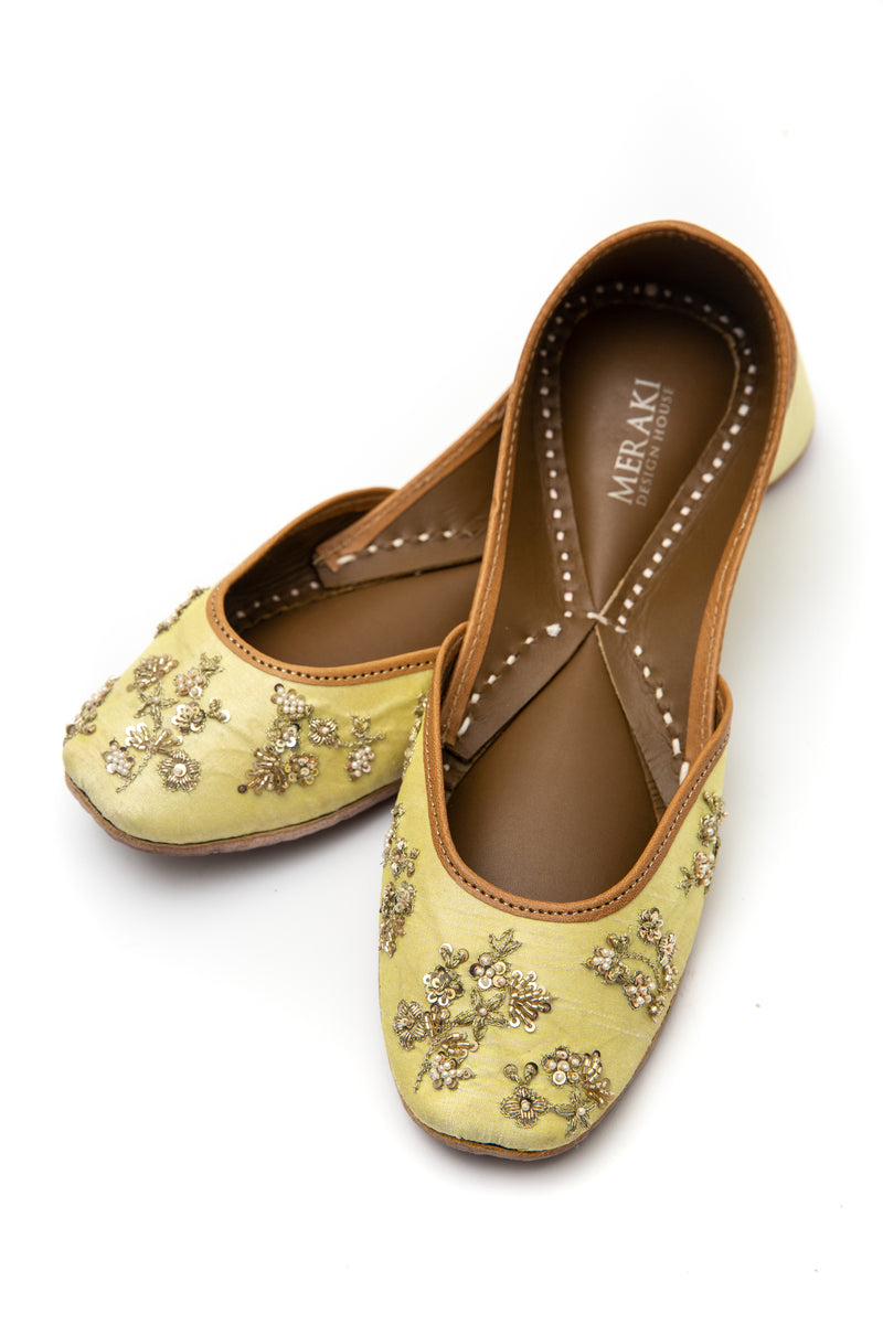 Handcrafted lemon flats, inspired by the traditional form of South Asian Khussa/Jutti. Made with 100% genuine leather to keep you comfortable regardless of the occasion.