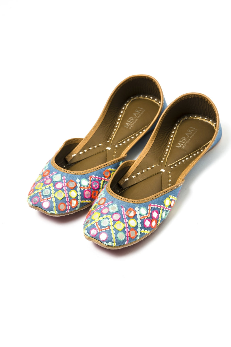 Handcrafted denim flats, inspired by the traditional form of South Asian Khussa/Jutti. Made with 100% genuine leather. Mirror work flats, to keep you comfortable regardless of the occasion.