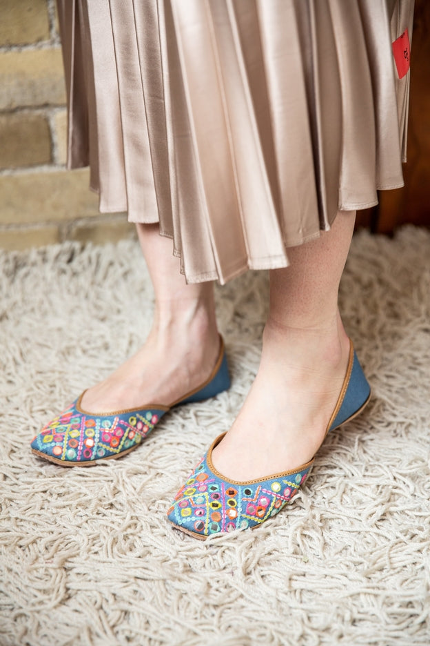 Handcrafted denim flats, inspired by the traditional form of South Asian Khussa/Jutti. Made with 100% genuine leather. Mirror work flats to keep you comfortable regardless of the occasion.