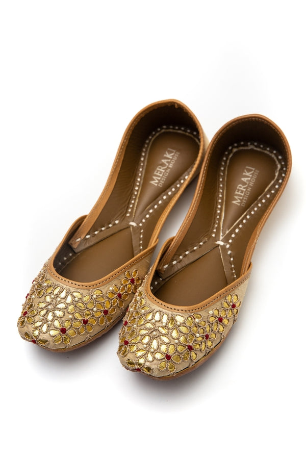Handcrafted golden flats, inspired by South Asian Khussa/Jutti design. Made with 100% genuine leather. Comfortable and fancy flats perfect for a night out or a wedding. Must have shoes.
