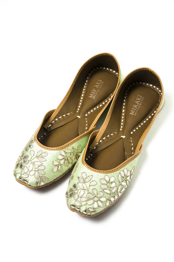 Handcrafted pale green flats, inspired by South Asian Khussa/Jutti design. Made with 100% genuine leather. Intricate gota embroidery and comfort come together to bring the most perfect flats for any occasion.