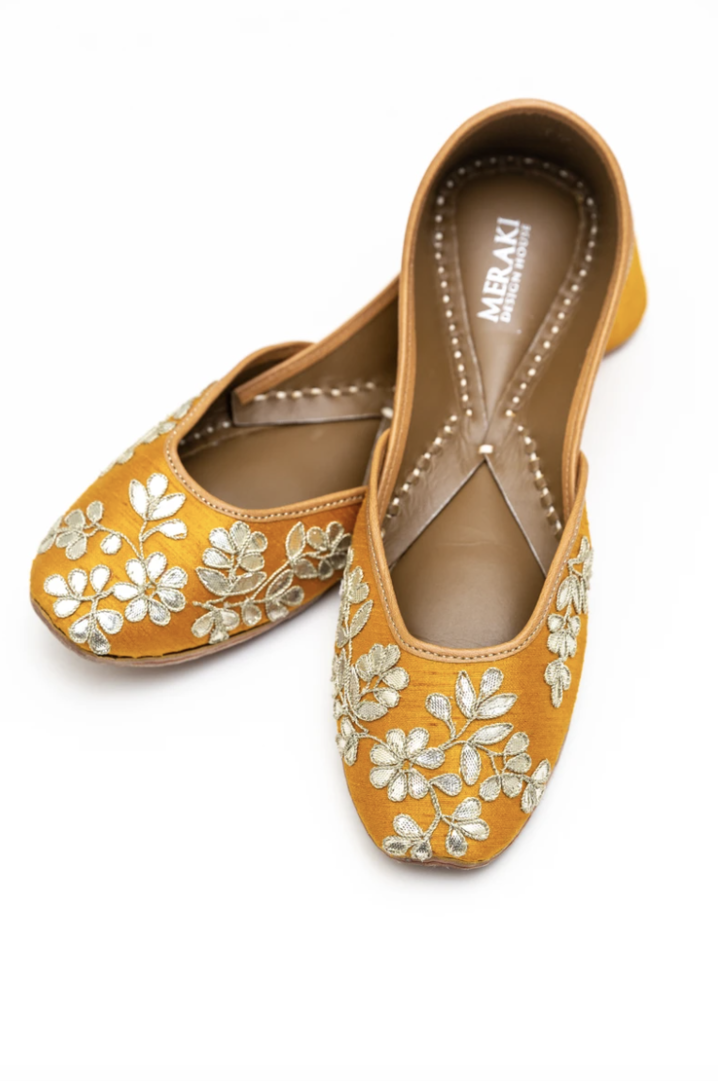 Handcrafted yellow flats, inspired by South Asian Khussa/Jutti design. Made with 100% genuine leather. Intricate embroidery and comfort come together to bring the most perfect flats for any occasion, especially summer dates and weddings.