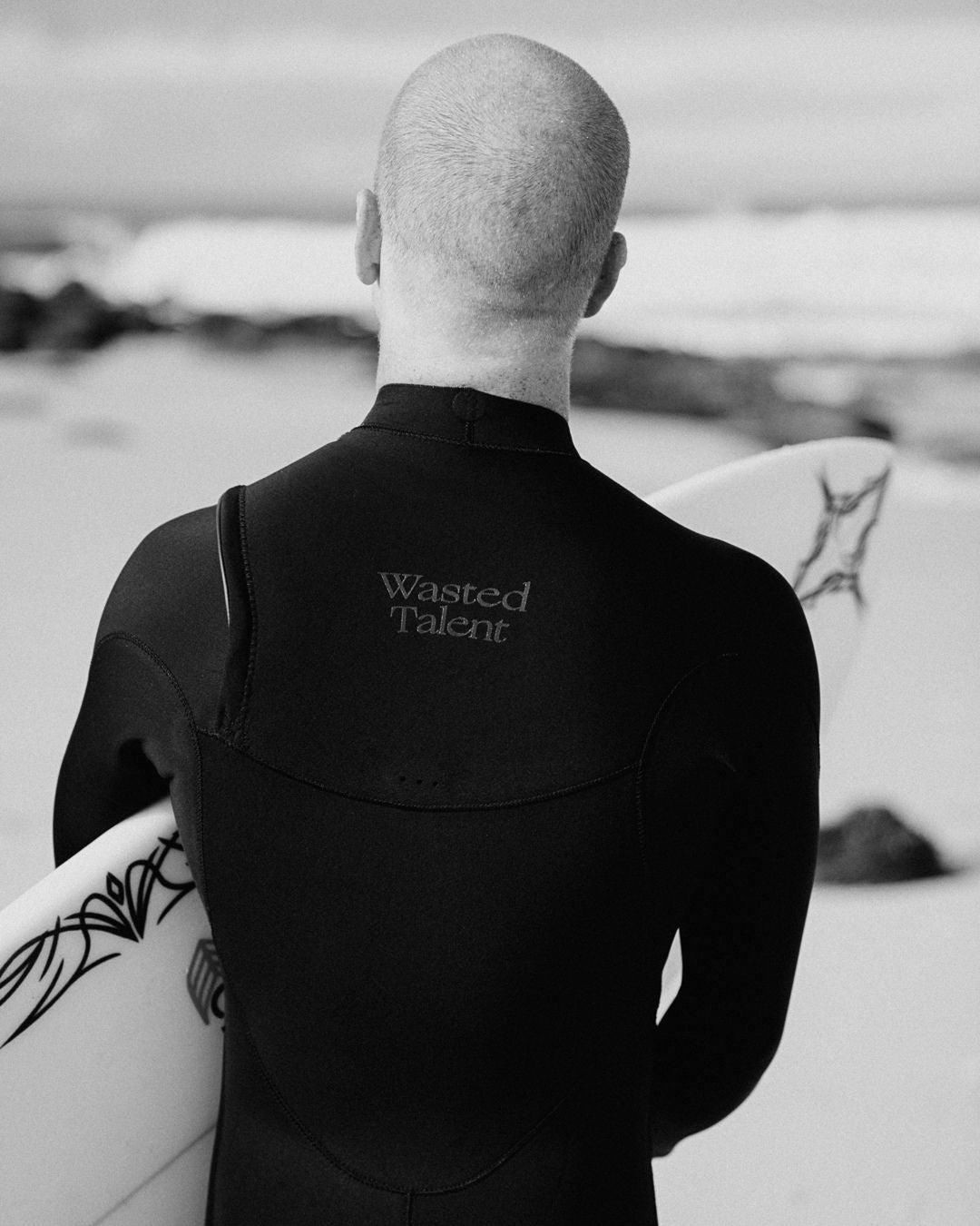 chippa wilson surfing for wasted talent and adelio wetsuits collab