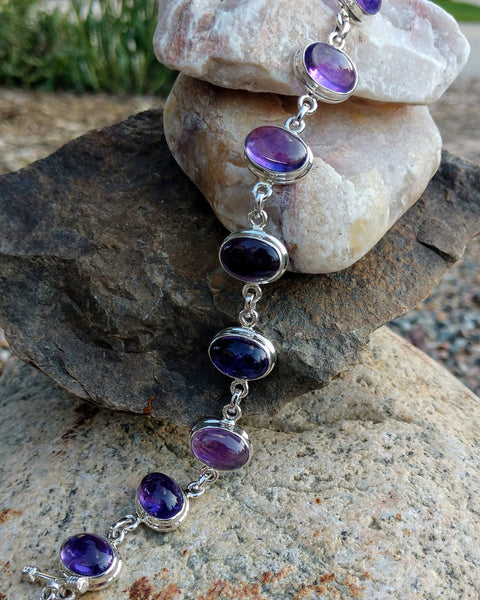 Amethyst bracelet in sterling silver setting.
