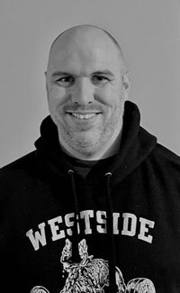 "<h1 class=""light-blue"">Mike Beckett</h1> <h4>Weak.Things.Break Manager </h4> <p>Mike came on board in 2019 as Westside Barbells purchasing manager. His knowledge of screen printing and textile procurement made him a huge asset to the companies growth. </p><p>  </p><p>In 2020 Westside Barbell launched a sister printing company called Weak.Things.Break® of which Mike manages its day to day operations while maintaining and building its current portfolio of clients.  </p><h6>Favorite Gym Exercise </h6><p>Sled Drag's</p> <h6>Unique Fact</h6><p> Avid Reader</p> <h6>Favorite Louie Quote  </h6><p>'Weak.Things.Break'</p> <p>Email: <a href=""mailto:Team@westside-barbell.com"">Mike@westside-barbell.com</a></p>"