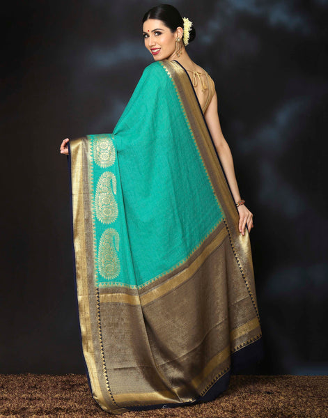 Meena Bazaar:  Woven saree with golden temple and paisley border.
