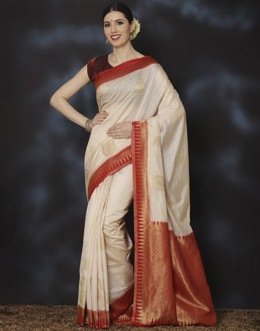 Meena Bazaar:  Woven saree with self-design floral jaal with paisley motifs