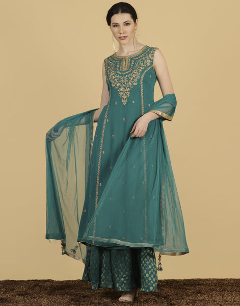 Meena Bazaar: Anarkali style georgette suit with golden embroidery.