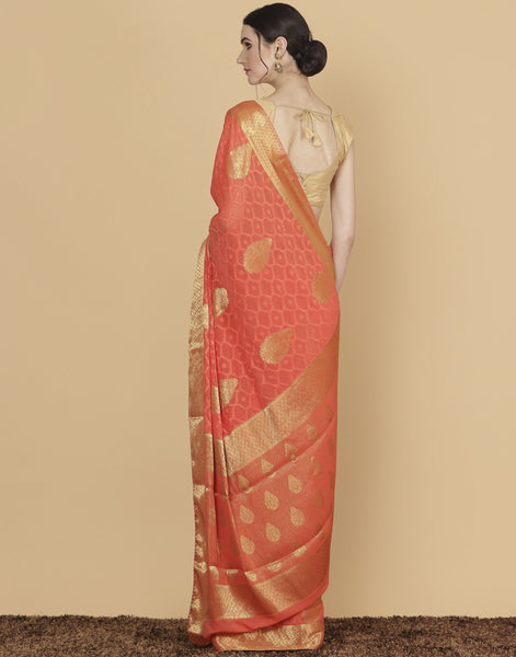 Meena Bazaar: Woven saree with golden floral booties