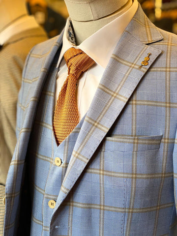 Fratelli Sky Blue Windowpane Check 3 Piece Look fratelli-tan-prince-of-wales-check-blazer / master-debonair-watson-navy-and-tan-check-tweed-waistcoat / master-debonair-white-shirt-with-floral-trim