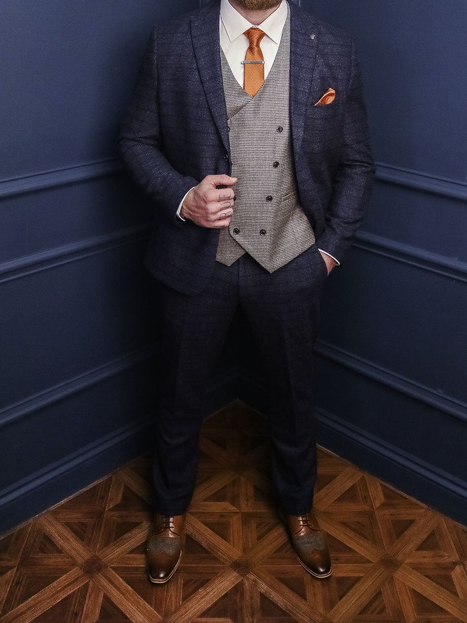 Moriarty & Holmes Smart Look master-debonair-bruce-grey-herringbone-tweed-blazer / master-debonair-rathbone-navy-herringbone-tweed-waistcoat / blend-dark-wash-jeans