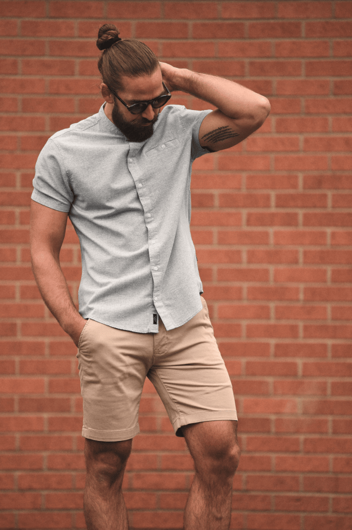 Simple Summer Style blend-sky-blue-cotton-grandad-short-sleeved-shirt / casual-friday-beige-chino-shorts / blend-white-leather-grain-sneakers