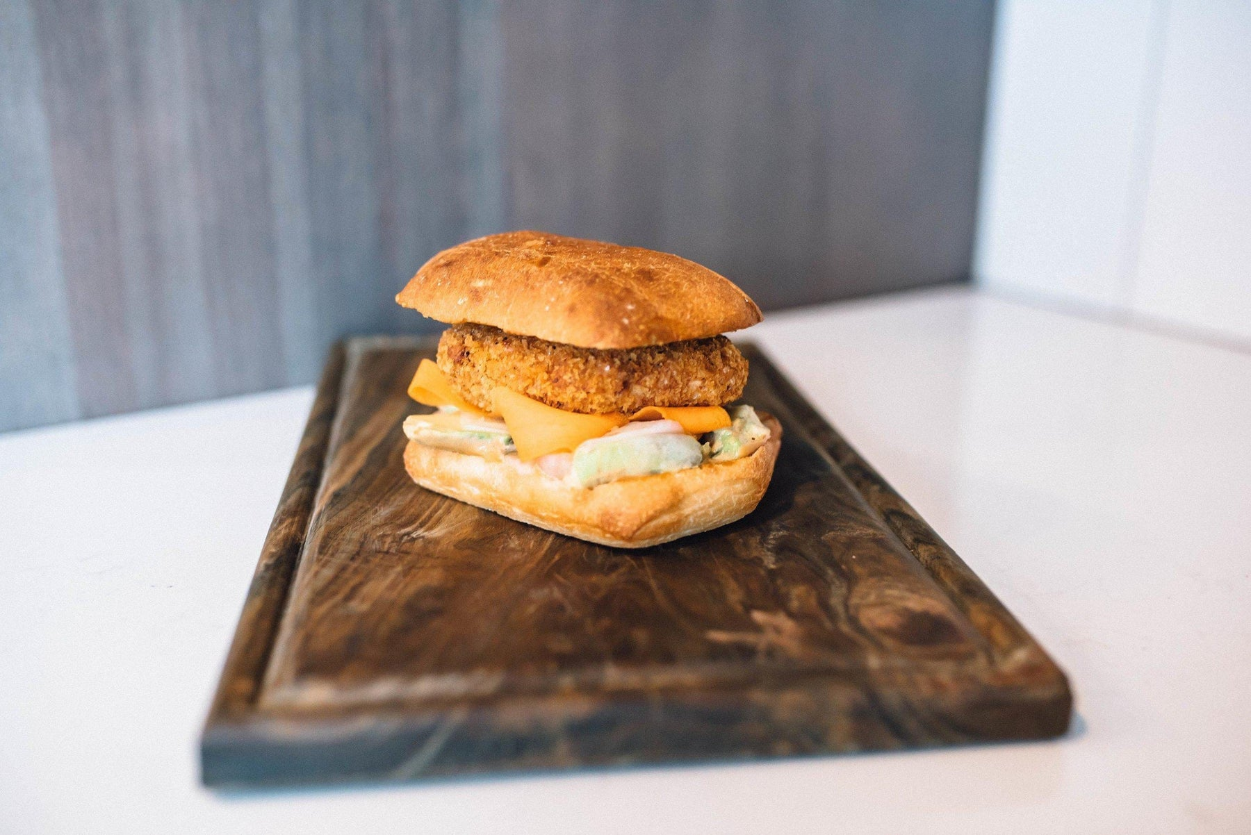 FRIED SALMON BURGER WITH MOLASSES MUSTARD AÏOLI