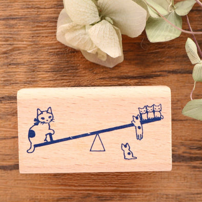 Pottering Cat Rubber Stamp - Seesaw