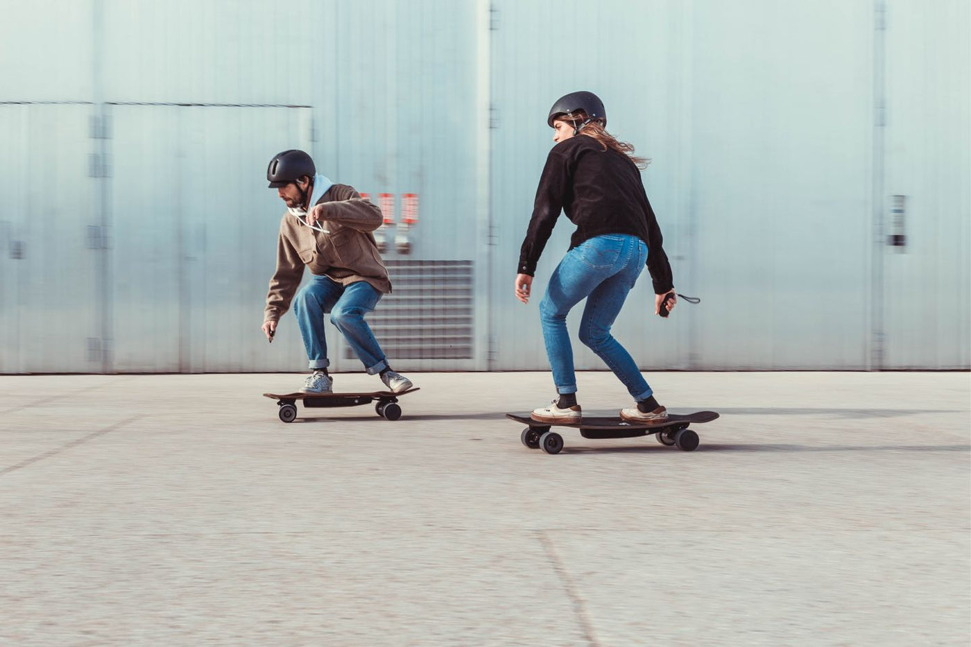 couple riding electric skateboard