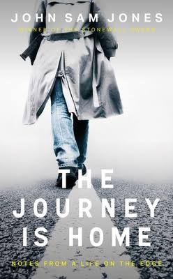 book cover of The Journey Home by John Sam Jones. pictures a man in a grey coat walking away from the camera