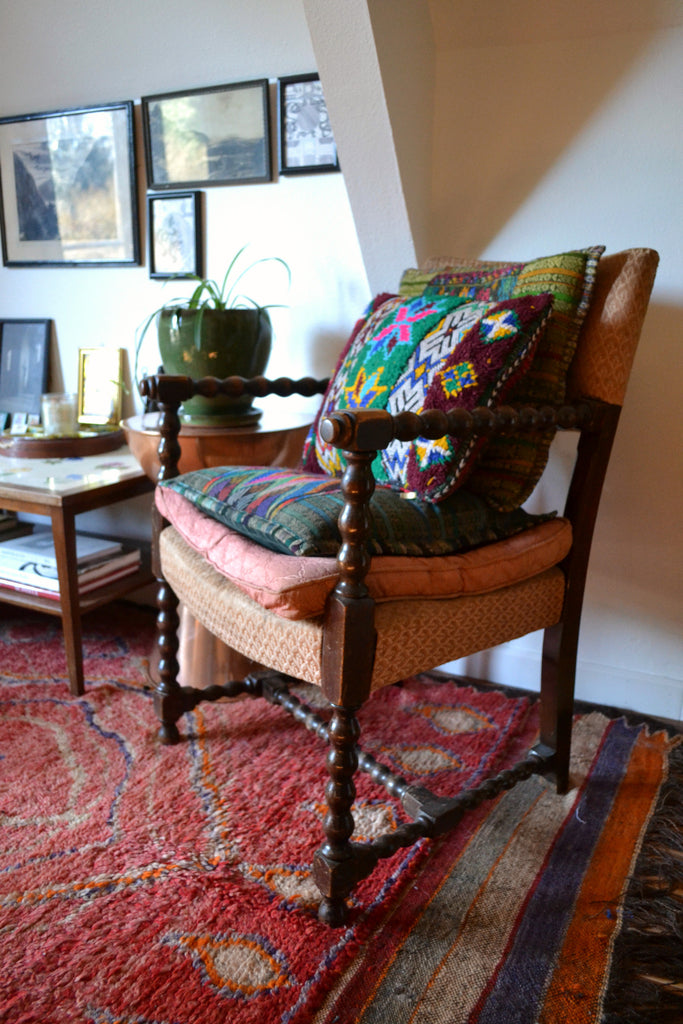 Moroccan rug, vintage chair, layered textiles, ethnic textiles, pillow shams