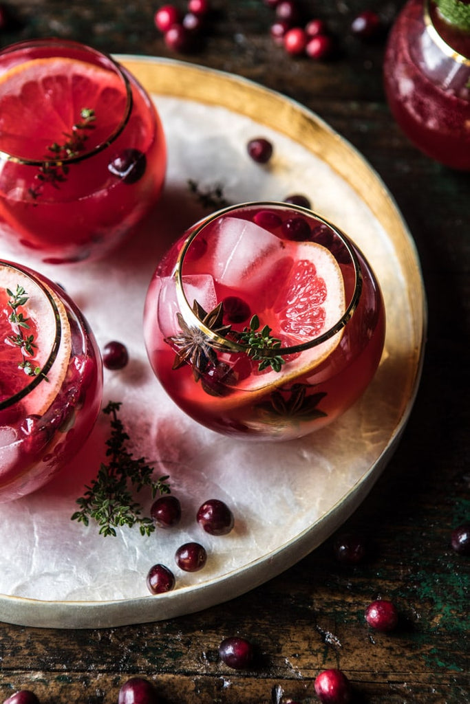Artifact's November Monthly Moodboard of rich tones of plum! Cranberry Thyme Spritz cocktail