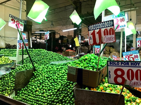 Mountains of limes in Mercado La Merced in Mexico City.