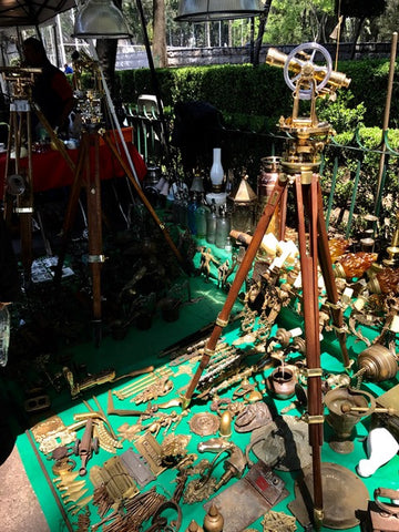 Telescopes and antique brass hardware at a flea market in Mexico City