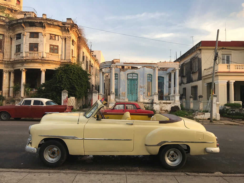 A yellow convertible taxi in Havana Cuba