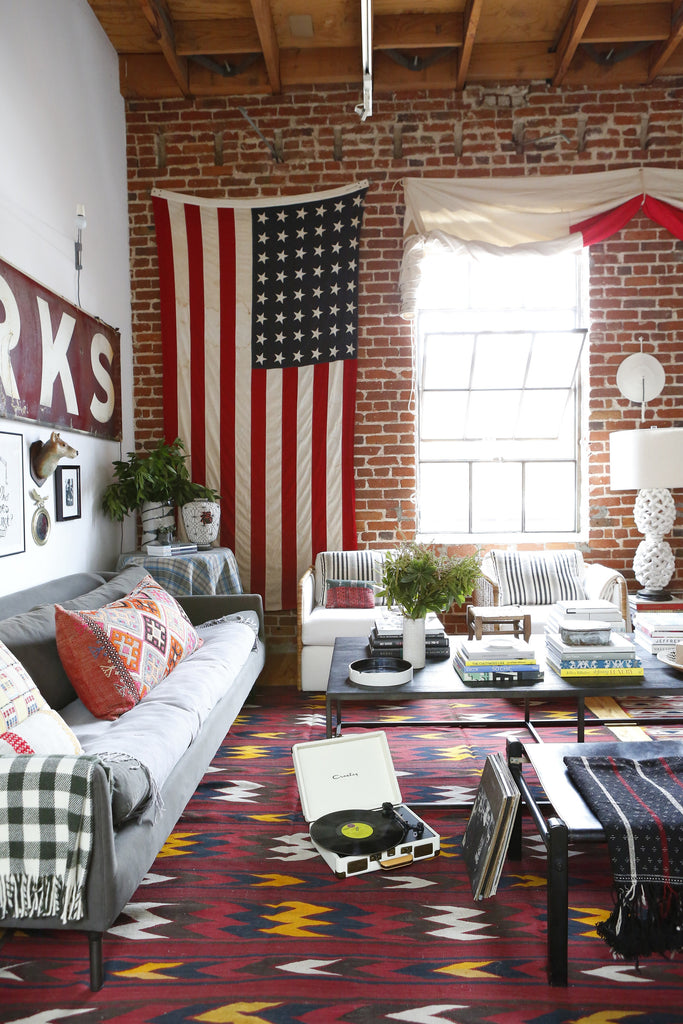 Home Tour with Portland Interior Designer, Max Humphrey. American flag, PDX, record player