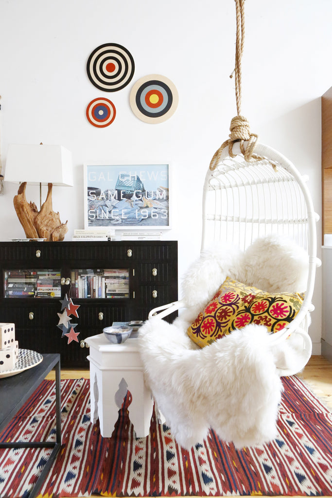 Home Tour with Portland Interior Designer, Max Humphrey. Hanging chair, gallery wall