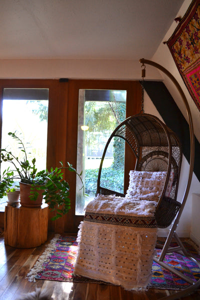 Swing chair, Moroccan textiles, plant goals