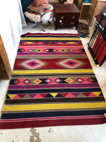 5x8' Bright Red and Pink Woven Rug