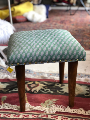 Green scalloped fabric stool