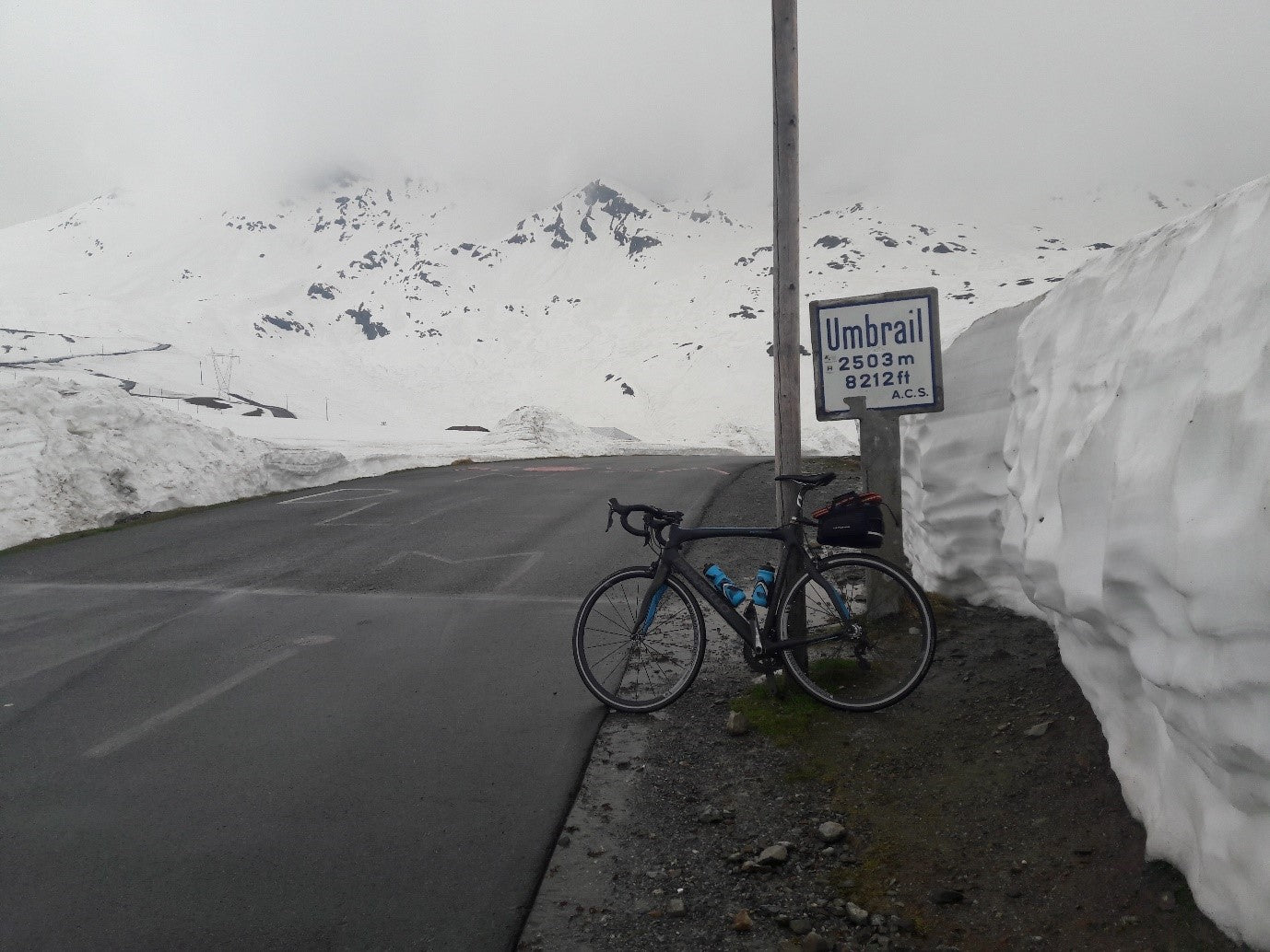 The top of the Umbrail pass. Note the road to the Stelvio summit on the left.