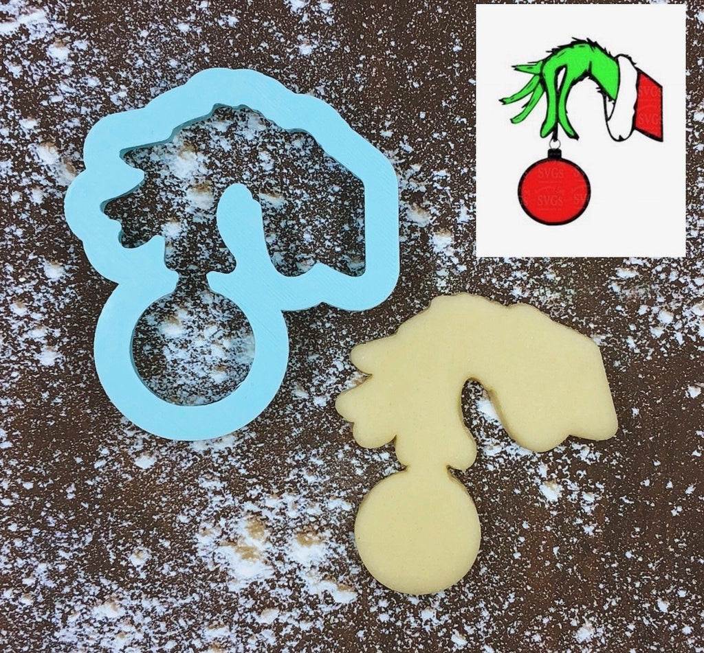Grinch Holding Ornament Cookie Cutter with Cookie