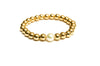 14kt Yellow Gold Filled Stackable Beaded Bracelet Adorned with One Fresh Water Pearl