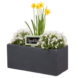 Small window box in Amalfi Black planted with spring flowers - Bay and Box