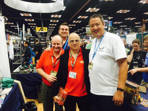 Cicero Ares & Roberto Di Meglio of Ares Games with Seth Hiatt & Ryan Bruns of Mayday Games. (GenCon 2015)