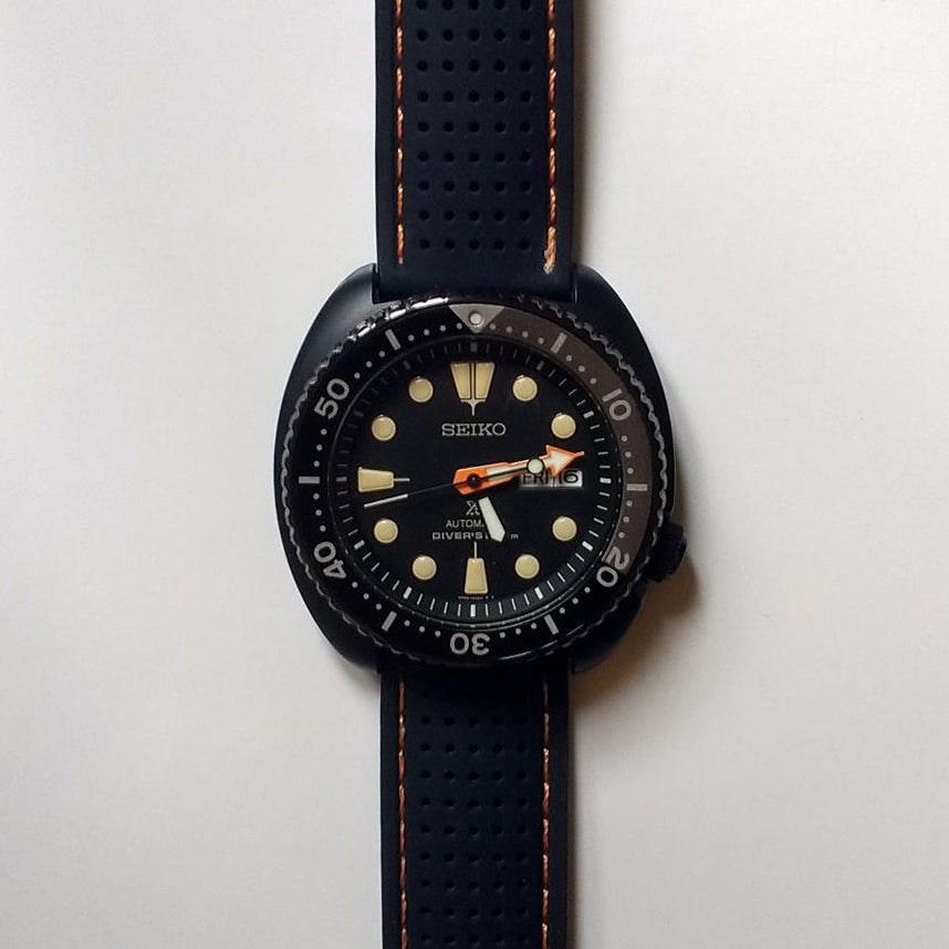 seiko watch on perforated watch strap