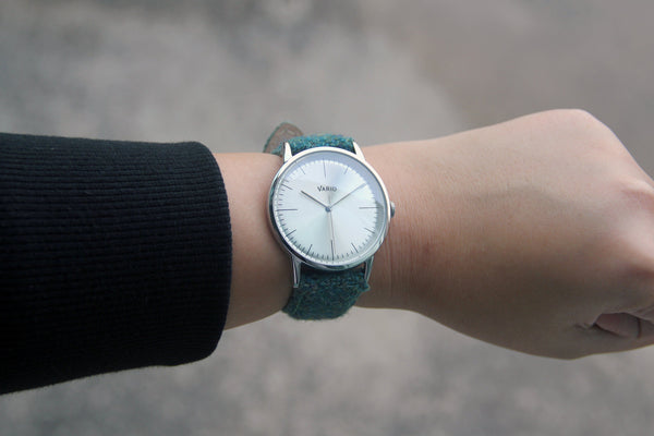eclipse 38mm silver dress watch with harris tweed strap on wrist