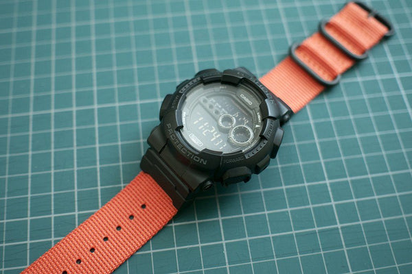 gshock gd100 with casio nato adapter and vario ballistic nylon strap orange