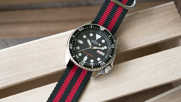 seiko skx007 dive watch with vario ballistic nylon orange black stripe single pass watch strap