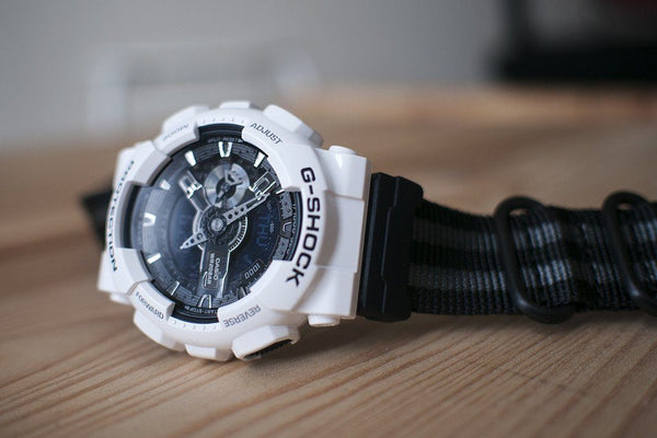 G-SHOCK GA110 with vario ballistic black and gray stripe nato band strap