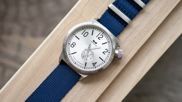 vestal watch with single pass navy blue seat belt nato