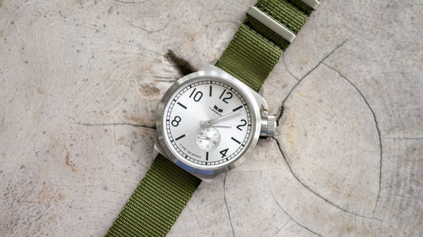 vestal watch with single pass olive green seat belt nato