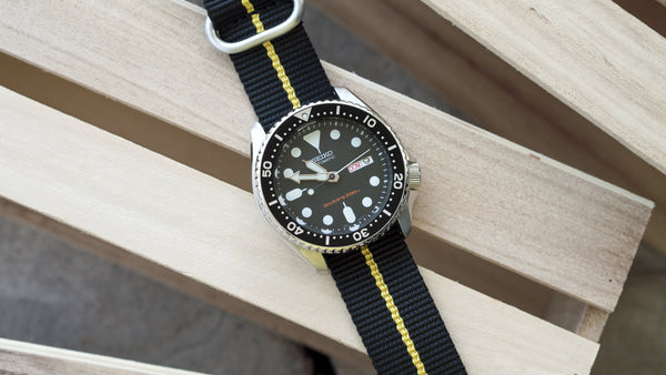 seiko skx007 dive watch with vario ballistic nylon yellow black stripe single pass watch strap