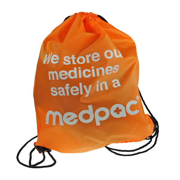 "medpac drawstring bag front view with ""we store our medicines safely in a medpac"" print"