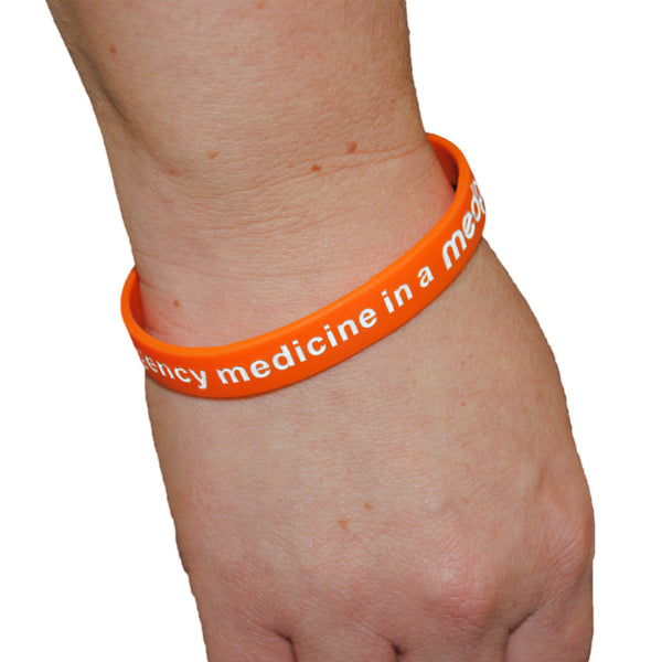 "medpac wristband on a wrist with ""I carry emergency medicine in a medpac"" print"