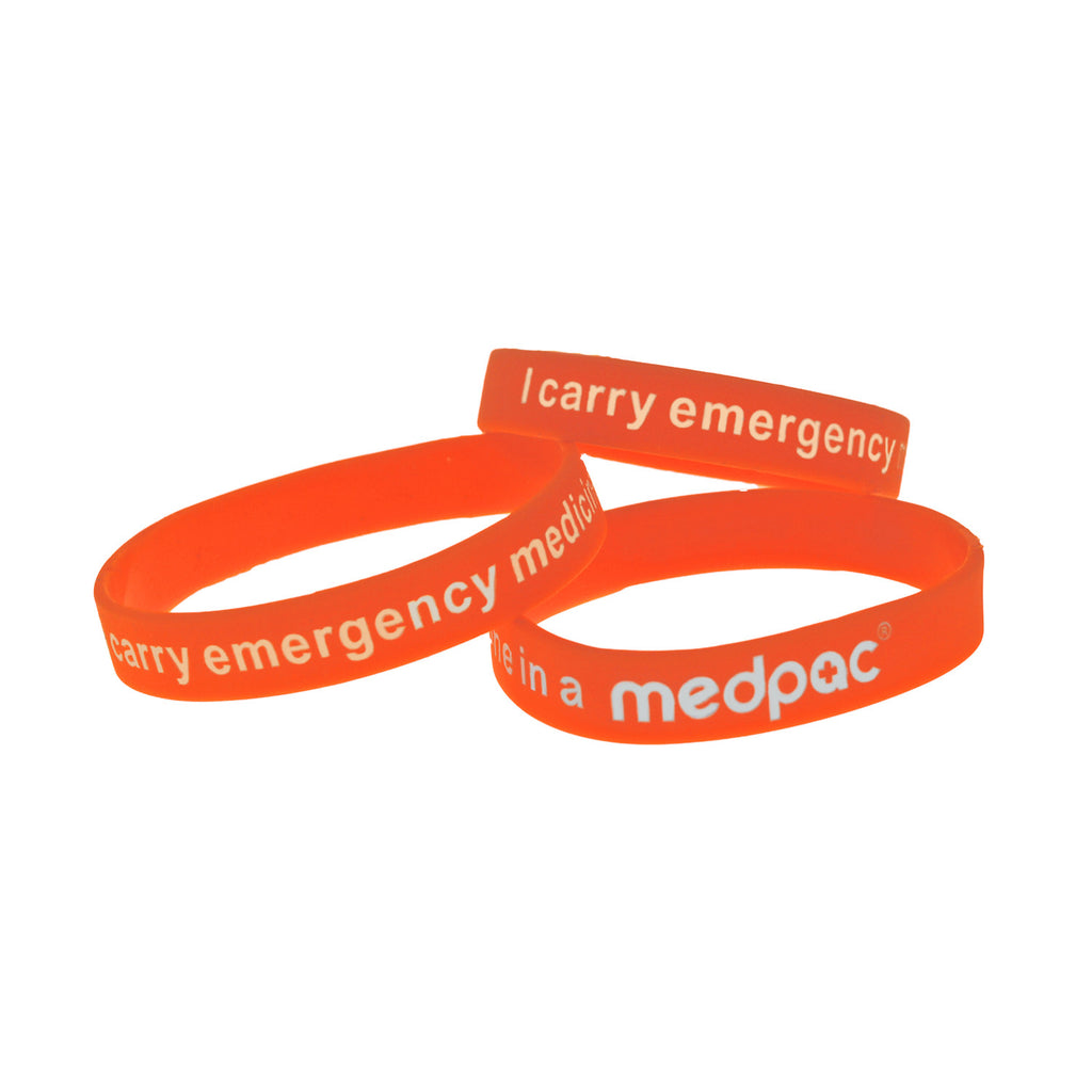 "three medpac wristbands in different sizes with ""I carry emergency medicine in a medpac"" print"