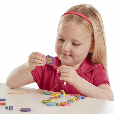 girl playing with Bead Bouquet - Wooden Bead Set