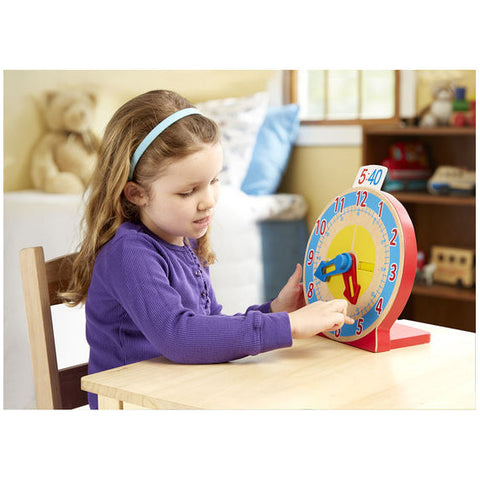 Girl playing with clock